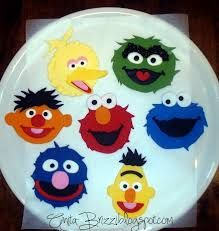 Image result for sesame street cake with fondant character faces around the cake