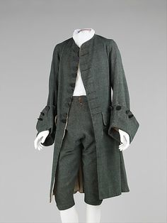 Men's wool and silk suit, British, 1755-65. The British aesthetic during the 18th C. tended to veer away from the ostentatious French styles. The textiles were more somber, the silhouettes more simple and the fashions more basic. Interestingly, nearing the end of Louis XVI's reign, the simple English styles were adopted by some Frenchman to express their rage towards the aristocracy. This suit is exemplary of popular dress in England with its somber wool, minimal decoration and plain…