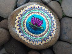 Hand Painted Lotus Flower with Mandala On Small River Rock.. $36.00, via Etsy.
