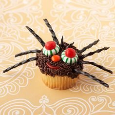 Halloween Spider Cupcake. More Halloween-inspired cupake ideas: http://www.bhg.com/halloween/recipes/17-frightfully-good-halloween-cupcakes/