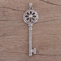Sterling silver pendant, 'Blossoming Key' - Sterling Silver Cubic Zirconia Flower Key Pendant from India