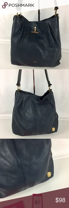 """Vince Camuto Pia Hobo Bag in Blue/Graphite Condition: Gently Used. Good condition overall. A couple of light marks on exterior.   Trimmed in contrasting deep blue and graphite Vachettaleather, this modern take on the classic hobo silhouette offers clean lines and touches of gleaming gold-tonehardware. 12""""H x 13""""W x 6.5""""D     Thank you for your interest! No Trades please. Vince Camuto Bags Hobos"""