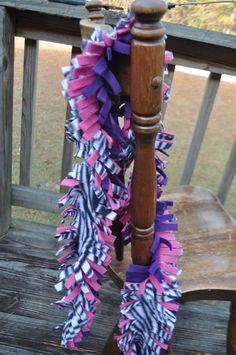 Fringed Fleece PInk and Purple by FlipflopBottlecaps,  sell for 8.50. This scarf is 50-60 inches in length with 1/2 inch fringe cuts. There are three layers of fleece--zebra, pink and purple. This fleece is very soft will keep you nice and toasty on those long, winter days. This scarf can also be worn as an accessory with a turtleneck or long sleeve shirt.