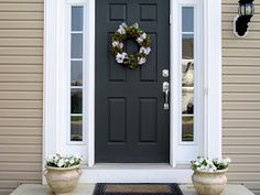 Black front door: gorgeous!  Love the windows either side too.