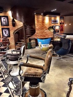 No idea where this is, but it appears to be a home man cave with a barber shop & waiting room theme. Seems to be an earlier work-in-progress photo of the place in my prior pin. If this is an actual barber shop, I'd love to know its name & location. Barber Shop Interior, Barber Shop Decor, Shop Interior Design, Barber Shop Chairs, Barber Chair, Tony Barber, Mobile Barber, Barber Logo, Barber Shop Quartet