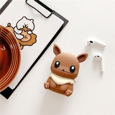 The cutest Pokemon has appeared. The Eevee Airpod Case is finally available in our shop. Catch this familiar Pokemon and protect your Airpods in the cutest way possible. FREE WORLDWIDE SHIPPING + Buy 2 Get 1 Free Pokemon Bulbasaur, All Pokemon, Cute Pokemon, Pokemon Phone Case, Iphone 11, Iphone Cases, Free Iphone, Instagram Cartoon, Accessoires Iphone