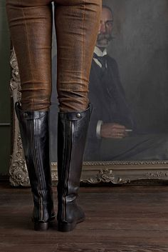riding boots & worn leather pants.  I love everything about this.