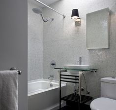 Supon Phornirunlit/ Naked Decor contemporary bathroom. Bounce the light around. In a bathroom that receives little or no natural light, light-colored tiles reflect it and make things brighter. Iridescent glass tiles are a good choice for this.