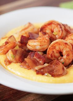 These shrimp and grits combine the delicious flavors of cheese and bacon!