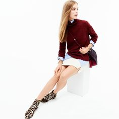 J.Crew Looks We Love: women's relaxed turtleneck sweater with rib trim, Secret Wash shirt in end-on-end cotton, double-notch mini skirt, leather calf hair saddlebag, crystal cluster bracelet and Collection calf hair ankle boots.