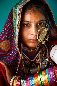 Portrait of a woman from the Marwada Meghwal Harijan tribe wearing traditional clothing and a large golden wedding ring through her nose in the village of Bhirendiara, located roughly 50km from Bhuj in the Kutch District