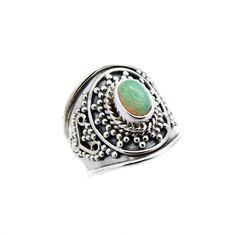 A stunning 925 sterling silver ring featuring a genuine Ethiopian Opal surrounded by a beaded design. The perfect ring for a summer boho style. -925 sterling silver.-Opal measures 7x5mm.-Band width: 17mm-High polish, oxidised. Due to the natural properties of Opal each stone is unique and will vary in colour from our stock photo. To maintain the beauty of your genuine Opal stone, this item should never be soaked or immersed in liquids.