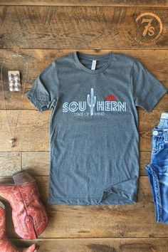 """The Southern State of Mind - """"Southern State of Mind"""" graphic t-shirt. Saguaro and sun graphic. White and red graphics on heather grey. Super soft tee. Junior size t-shirt, long thru bodice."""
