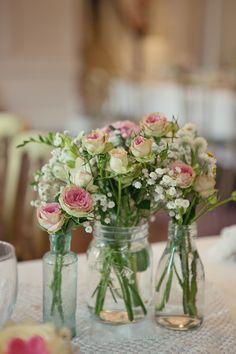 Rustic flowers in jars