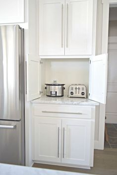 kitchen remodel ideas white kitchen carrara marble counter tops appliance cabinet - Welcome to our transitional modern white kitchen tour! I sure hope you enjoy the tour of this entire space as much as we enjoy using it! White Kitchen Cabinets, Kitchen Cabinet Design, Kitchen Pantry, Kitchen Countertops, Kitchen Ideas, Kitchen White, Kitchen Decor, Country Kitchen, Laminate Countertops