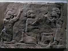 ASSUR RELIEF 10TH-6TH BCE Elamite prisoners eating. Detail from a stone bas-relief (7th BCE) from the palace of Ashurbanipal in Niniveh, Mesopotamia (Iraq). British Museum, London, Great Britain