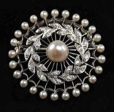 Edwardian Platinum Pearl and Diamond Pin Wheel Pin Brooch. by shannon