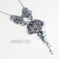 "#Sabrinah's Art ""Monsoon"" Blue #Zircon and Sterling Silver #Wire Wrapped #Necklace. #ArtJewelry"