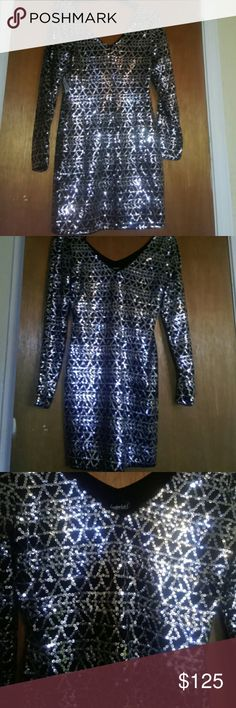 NWT....Sequin Dress Ladies!!!! Great New Year's dress...sexy...slits just below shoulders.N this dress shoes every curve n lump n bump...lol!!! Frederick's of Hollywood Dresses