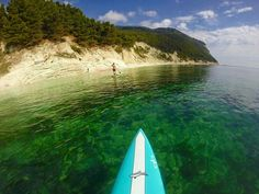 Stand up paddling in Sirolo, the Conero riviera Italy