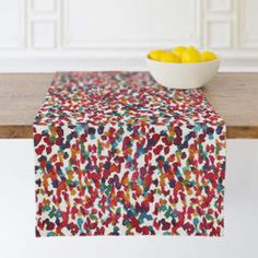 Pops-of-color table runner is a fun touch to liven up your table setting. Colorful marks II Self-Launch Table runners Modern Table Runners, Accent Decor, Color Pop, Ottoman, Table Settings, Product Launch, Touch, Colorful, Chair
