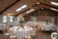Tall silk table arrangements and hanging wicker balls with fairy lights
