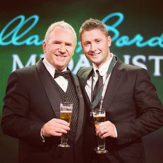 Allan Border joins Michael Clarke for a toast after presenting the Australian skipper with his 4th #ABMedal