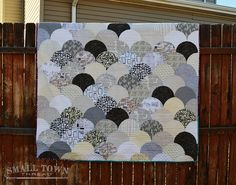 Glam Clam Quilt: Pattern by The Quilt Engineer - Quilt Stats: Final Size | 58″ x 68″ Fabrics Used | Various low-volume prints, Waterfront Park Domino Dots for the binding, Ikea Britten Nummer for the back. Thread | Aurifil 50 wt. in White 2024 #aurifil Batting | Warm and Natural 100% Cotton