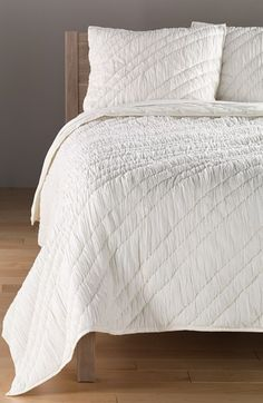 Beautiful white quilt and sham for a clean classic look