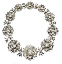 AN ANTIQUE DIAMOND NECKLACE   Designed as a graduated series of ten old mine-cut diamond flower blossoms, joined by similarly-designed foliate links, mounted in silver and gold, circa 1806; from Rundell, Bridge and Rundell, London