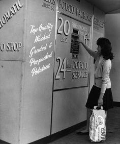 A woman operating the first vending machine in Britain to sell potatoes at a greengrocer's shop at Chelsea, London. The machine provides a round-the-clock service. Get premium, high resolution news photos at Getty Images Drive In, Arcade, Slot, Juke Box, 24 Hour Service, Weird Vintage, Vintage Signs, Vintage Ads, Tecno