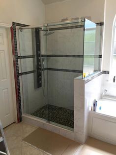 Frameless Shower With Door And Large Inline Notched Panel