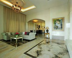 Our clients grand formal seating area featuring our book-matched marble floor tiles