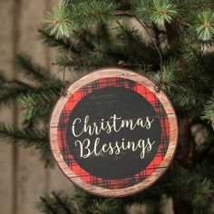"Christmas Blessings Sign Size: 7"" x 7"" Material: Metal Color: Red & Black Plaid edge, black center with cream wording. Wood slat look, metal sign with hanger."