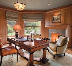 Home office paneled in rich cherry including a Rumford fireplace