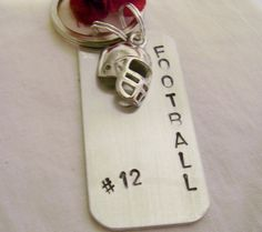 Football key chain hand stamped says football by glamgirlspretties, $18.00