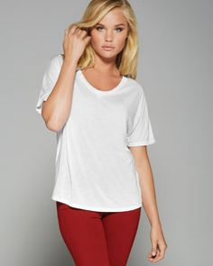 8816 Ladies' Flowy Simple T-Shirt      Easy, relaxed fit     Conservative scoop neck     Longer body length