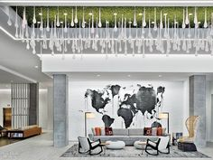 In reception, a custom chandelier's handblown glass drops and a Patricia Urquiola woven chair keep company with an acrylic-painted mural by Ryan Coleman. Rottet Studio Makes Layovers a Luxury at Renaissance Atlanta Airport Gateway Hotel Lobby Interior, Interior Architecture, Interior Design, Vinyl Wall Covering, Atlanta Airport, Office Ceiling, Floating Bed, Woven Chair, Waiting Area