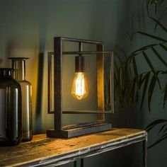 This industrial table lamp has a single light source, is made of metal and is finished with a charcoal touch. The light source distributes the light in a beautiful way through the room, creating a great ambiance. Industrial Floor Lamps, Industrial Ceiling Lights, Industrial Table, Industrial Living, Indoor Wall Lights, Retro Lampe, Drop Lights, Beautiful Lights, Candle Sconces