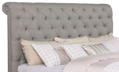 Recreate the feeling of Paris in the spring with this upholstered headboard. With an elegant colour and long, curling lines, this fabric design will leave you with a feeling of romantic whimsy. Button-tufting along the front of the headboard creates a cozy and traditional look, while the milled feet deliver delightful contrast to the fabric above. And underneath the soft upholstery, the pine frame offers all the strength and sturdiness you need for a sound night's sleep.
