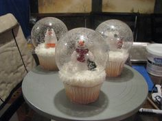 Snowglobe Cupcakes (Snowglobe part is a plastic ornament, slightly wet and swirled with white decorating flakes)