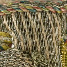 Detail of draw cord and upper edge finish. Image by Cristina Balloffet Carr. early 17th century, British. Canvas worked with silk and metal thread, glass beads, spangles; Gobelin, tent, and detached buttonhole stitches; silk cord and silk and metal thread tassels. 5 1/8 x 5 1/8 in. (13 x 13 cm), excluding tassels and draw cord. Rogers Fund, by exchange, 1929 (29.23.15)
