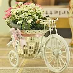 Milan Bract Flower. With a cute vase like this, it's a sweet little present for your mom on Mother's Day isn't it?