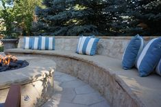 Mediterranean Courtyard | Custom Buff and Limestone Bench and Fire Pit | Denver, Colorado | by Prolithic Designs