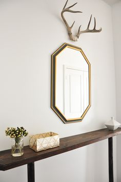 Love this gorgeous entryway with a narrow side table!