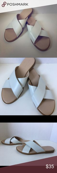 """NEW H by Halston rin slide sandals sz 6.5 BRAND NEW. Simple and stylish, these sandals from H by Halston are the quintessential footwear find of the season. The slide-on design gives them a casual feel, while the leather crossover straps add a fashionable flair. From H by Halston. Style: Rin Slide-on style, crossover straps, top stitch details, rounded toe Padded insole, textured outsole Approximately 1/2""""H heel Fit: true to size Leather upper; man-made balance Imported H by Halston Shoes…"""