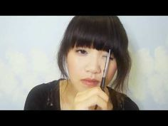 A tutorial for cutting your own bangs.  I found this helpful.