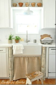 Countertops For Kitchens and Beyond: Painting mismatched wood white leaves the kitchen light and airy