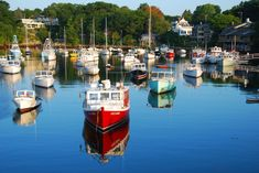 Perkins Cove Harbor - Ogunquit, Maine | This is a classic shot of the Perkins Cove Harbor, as taken from the footbridge over the harbor. The red boat in the front is the Ugly Anne.