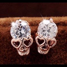 Crystal Skull Earrings New crystal gold plated skull earrings.. Bundle and save. Jewelry Earrings
